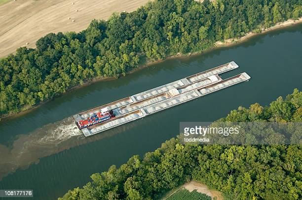 aerial view of tug and barges carrying gravel - barge stock photos and pictures