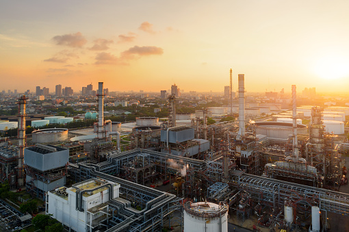 Aerial view of twilight of oil refinery ,Shot from drone of Oil refinery plant ,refinery Petrochemical plant at dusk , Bangkok, Thailand 1054969666