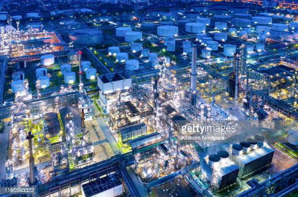 aerial view of twilight of oil refinery ,shot from drone of oil refinery plant ,refinery petrochemical plant at dusk , bangkok, thailand. - oil refinery stock pictures, royalty-free photos & images