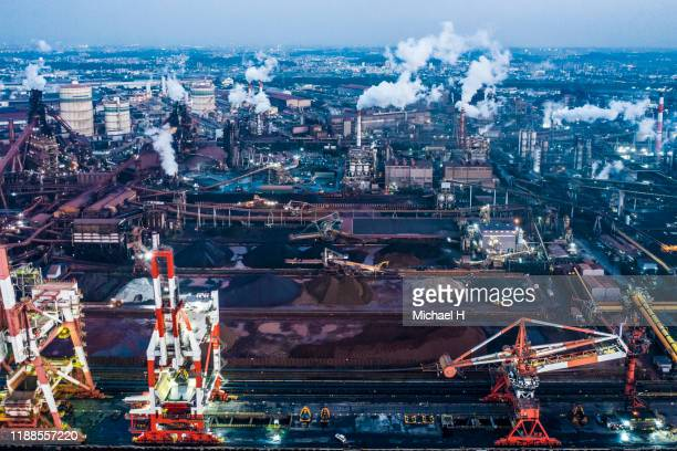 aerial view of twilight of refinery plant ,petrochemical plant at dusk - environmental damage stock pictures, royalty-free photos & images