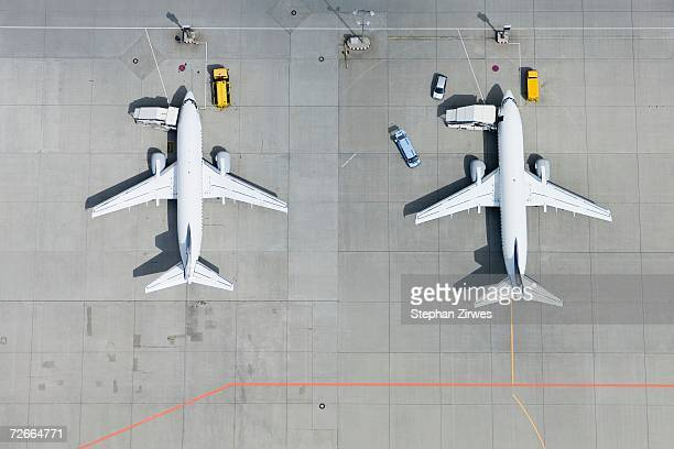Aerial view of two airplanes on tarmac