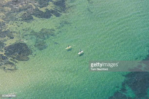 Aerial view of two paddle boarders, St Kilda, Melbourne, Victoria, Australia