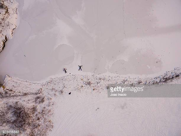 Aerial view of two women playing on the snow - Finland