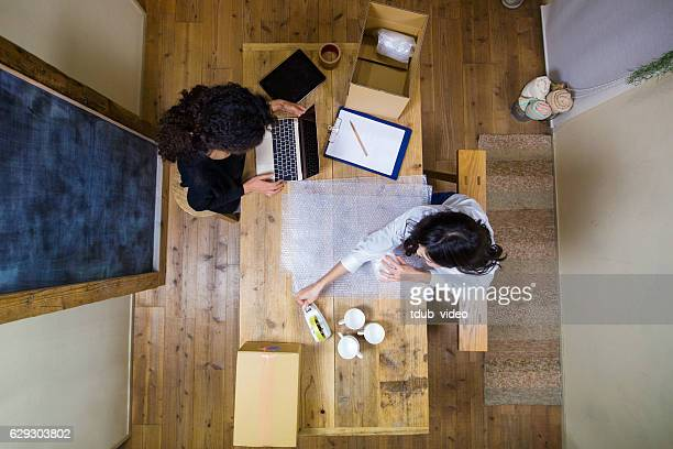 aerial view of two women working - tdub_video stock pictures, royalty-free photos & images