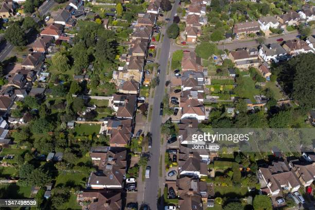aerial view of typical uk suburban houses with front drives and rear gardens. - st. albans stock pictures, royalty-free photos & images