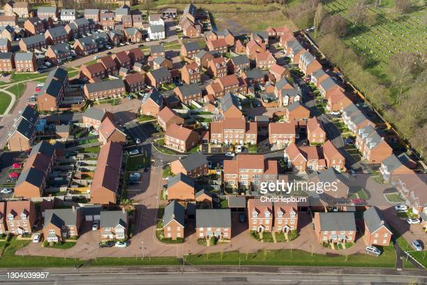 aerial view of uk new build residential area with large houses - drone point of view stock pictures, royalty-free photos & images