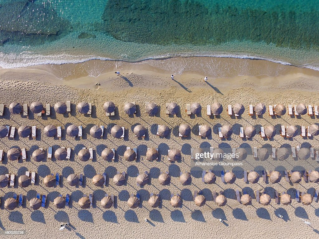 Aerial view of Umbrellas at Kalafatis Beach on July 01, 2015 in Mykonos Island, Greece. Mykonos is part of the Cyclades and have the nickname The island of the winds.
