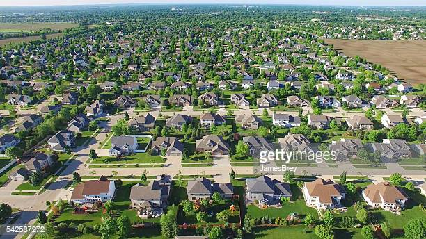 aerial view of upper class neighborhood on sunny morning. - residential district stock photos and pictures