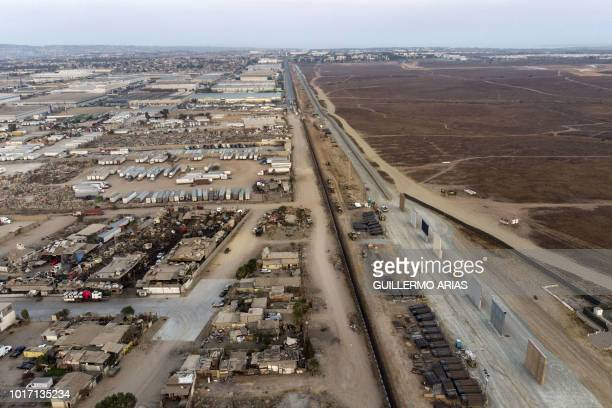 Aerial view of US President Donal Trump's wall prototypes in the MexicoUS border seen from Tijuana Baja California state Mexico on August 11 2018