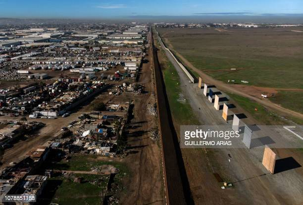 TOPSHOT Aerial view of US President Donald Trump's border wall prototypes as seen from Tijuana in Baja California state Mexico on January 7 2019 US...