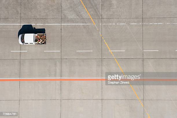 Aerial view of van driving across airport tarmac