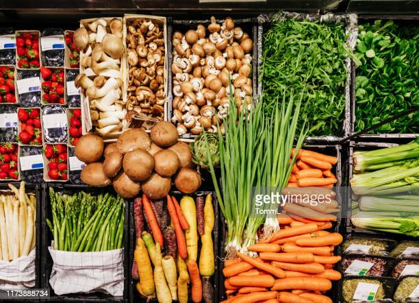 aerial view of various vegetables at supermarket - produce aisle stock photos and pictures