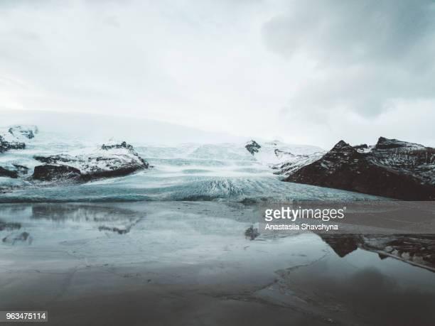 aerial view of vatnajokull glacier in iceland - crevasse stock photos and pictures