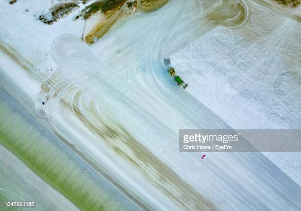 aerial view of vehicle on frozen lake - siesta key stock pictures, royalty-free photos & images