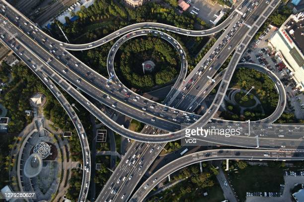 Aerial view of vehicles being driven along a road on the last day of the 8-day National Day holiday on October 8, 2020 in Wuhan, Hubei Province of...