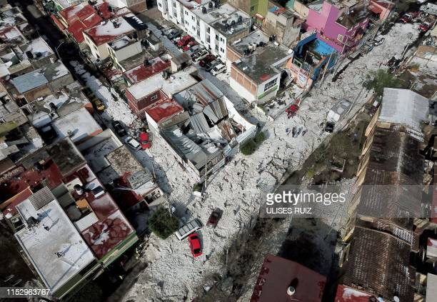 Aerial view of vehicles buried in hail in the streets in the eastern area of Guadalajara, Jalisco state, Mexico, on June 30, 2019. - The accumulation...