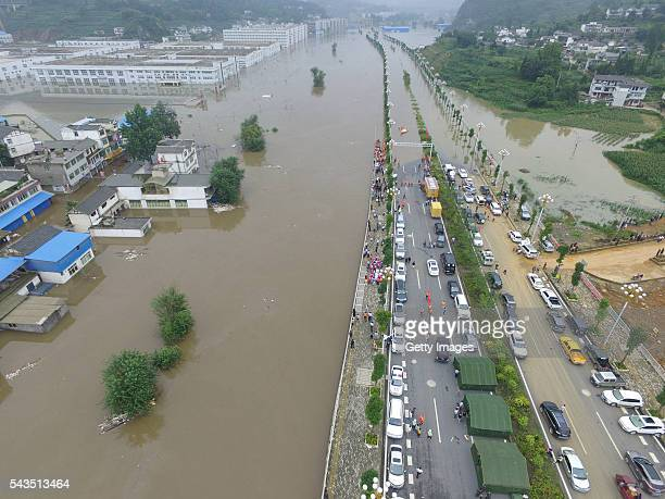 Aerial view of vehicles near the flood caused by heavy rain in Zhijin County on June 28 2016 in Bijie Guizhou Province of China Over 10 hours...
