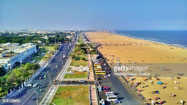 aerial view of vehicles on road by beach against sky - chennai stock pictures, royalty-free photos & images