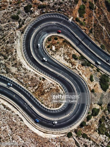 aerial view of vehicles on winding road - letter s stock pictures, royalty-free photos & images