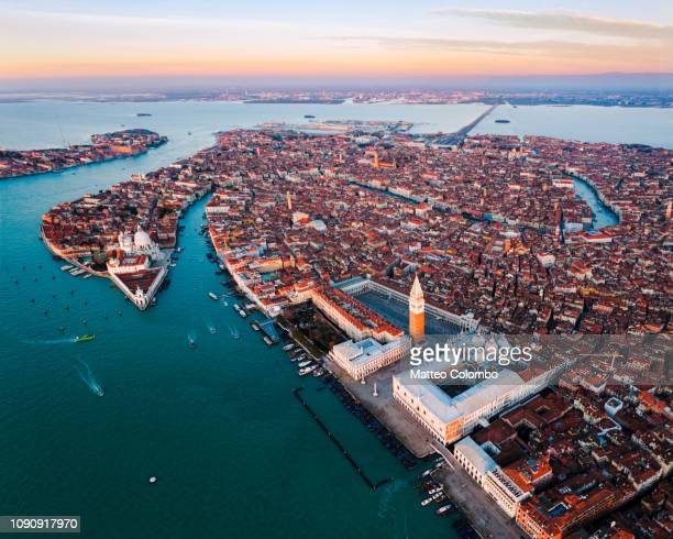 aerial view of venice at sunset, italy - venezia foto e immagini stock