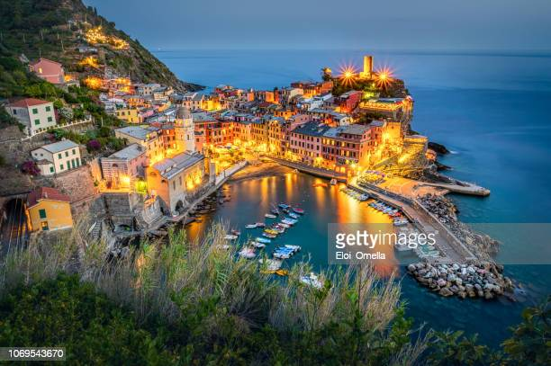 aerial view of vernazza at dusk. cinque terre. italy - cinque terre stock pictures, royalty-free photos & images