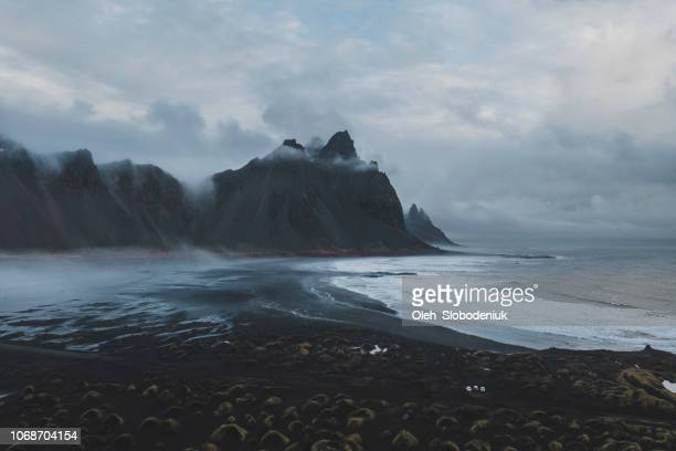 aerial view of vestrahorn mountains near the sea - dramatic landscape stock pictures, royalty-free photos & images