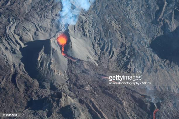 aerial view of volcanic crater lava with steam,reunion - vulcano attivo foto e immagini stock
