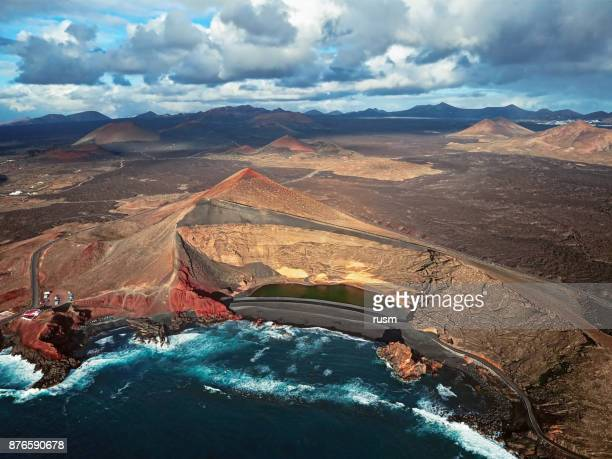 aerial view of volcanic lake el golfo, lanzarote, canary islands - timanfaya national park stock pictures, royalty-free photos & images