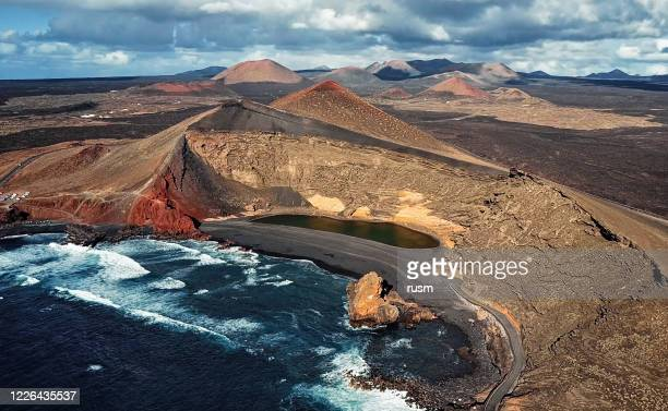 aerial view of volcanic lake el golfo, lanzarote, canary islands, spain - timanfaya national park stock pictures, royalty-free photos & images