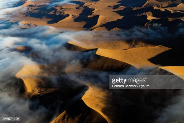aerial view of volcanic landscape against sky - gerhard schimpf stock pictures, royalty-free photos & images