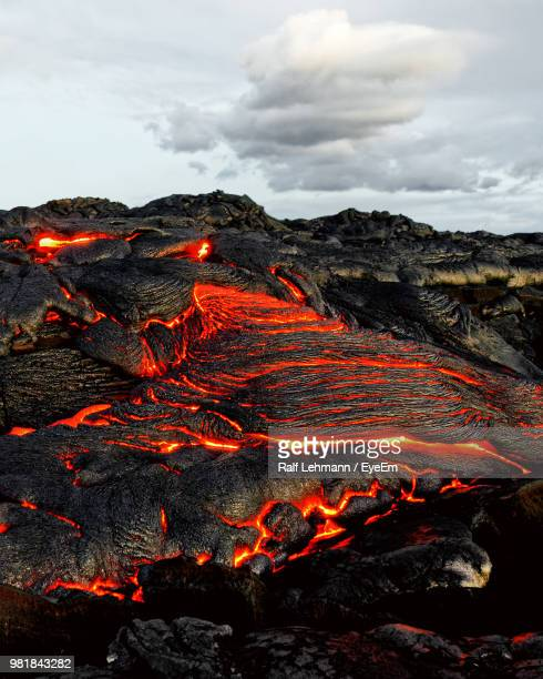 aerial view of volcano against cloudy sky - lava stock pictures, royalty-free photos & images