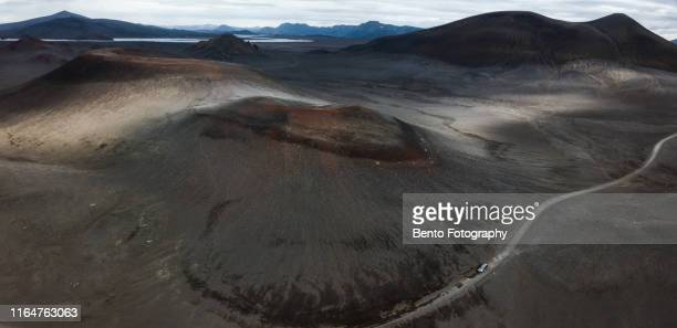 aerial view of volcanoes and gravel road in highland, iceland - paisaje volcánico fotografías e imágenes de stock