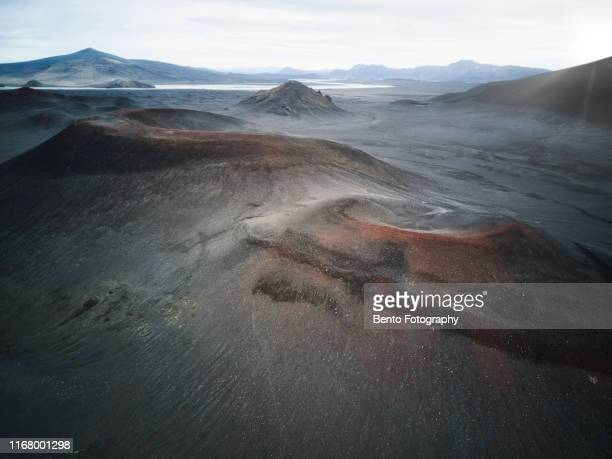 aerial view of volcanoes and gravel road in highland, iceland - iceland stock pictures, royalty-free photos & images