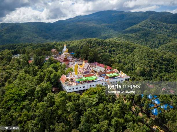 Aerial view of Wat Phra That Doi Kham Temple on the top of mountain in Chiang Mai, Thailand.