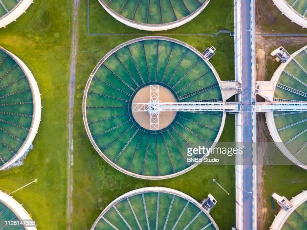 aerial view of water treatment plant - águas residuais imagens e fotografias de stock