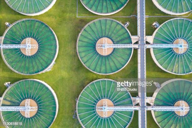aerial view of water treatment plant - ecosystem stock pictures, royalty-free photos & images