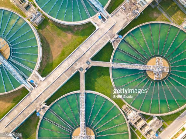 aerial view of water treatment plant - sewer stock pictures, royalty-free photos & images