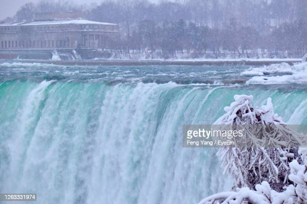aerial view of waterfall in winter - niagara falls stock pictures, royalty-free photos & images