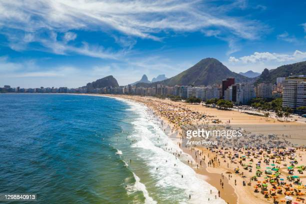 aerial view of waves at copacabana beach at sunny day. rio de janeiro, brazil. - copacabana stock pictures, royalty-free photos & images