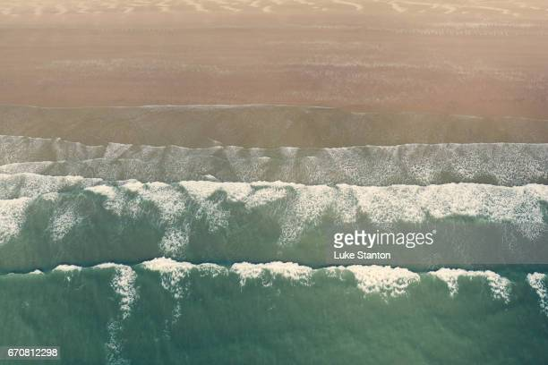 Aerial View Of Waves At Surfing Beach