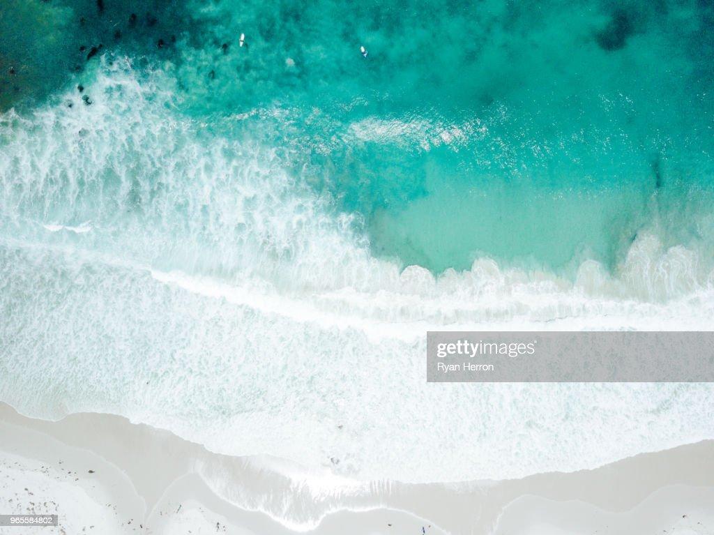 Aerial View of Waves Crashing on Sandy Beach : Stock Photo