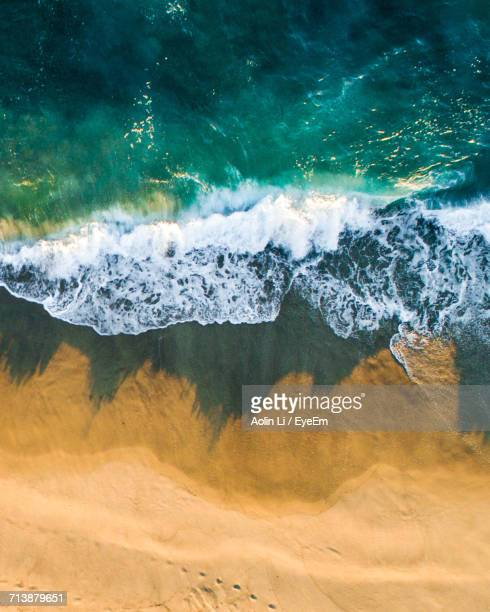 Aerial View Of Waves On Sea At Beach