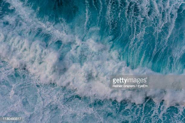 aerial view of waves splashing in sea - ilha da madeira imagens e fotografias de stock