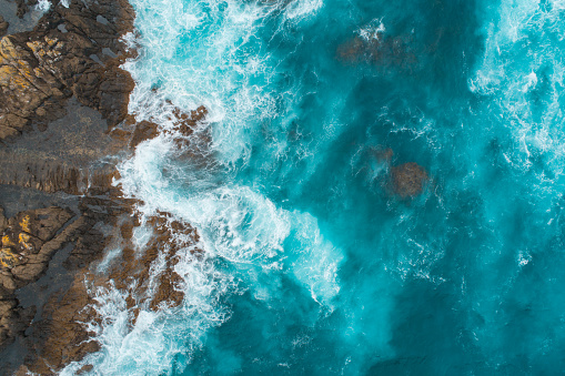 Aerial view of waves splashing on beach. 1139797968