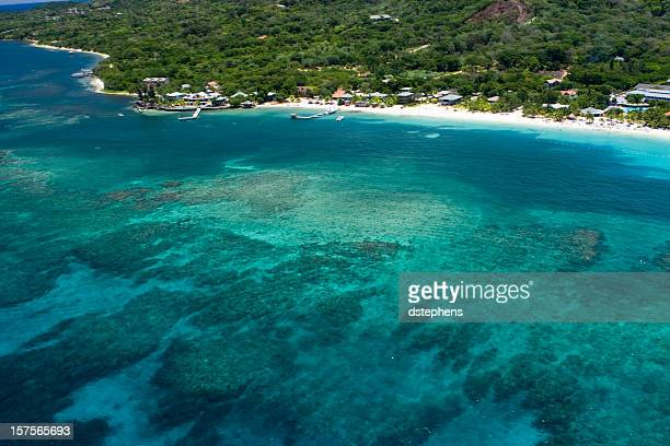 aerial view of west bay beach and caribbean sea - honduras stock pictures, royalty-free photos & images