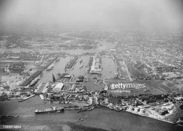 Aerial view of West India Docks a series of three docks looking west from the Isle of Dogs with Blackwall Reach in the foreground and Limehouse Reach...