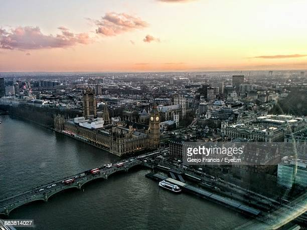 Aerial View Of Westminster Bridge Over River By Buildings Against Sky At Dusk In City