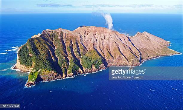 aerial view of white island volcano in bay of water - white island new zealand stock photos and pictures