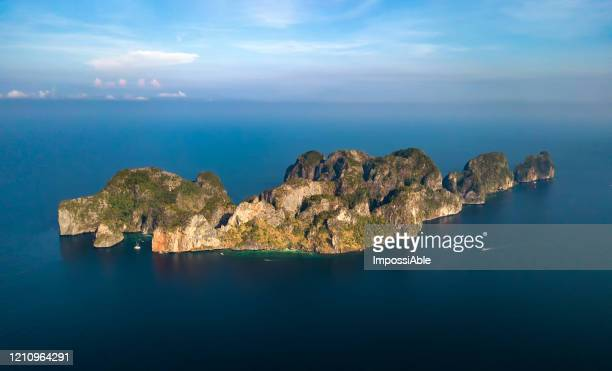aerial view of whole phi phi le island during morning sunrise, andaman sea , krabi, thailand - impossiable stock pictures, royalty-free photos & images