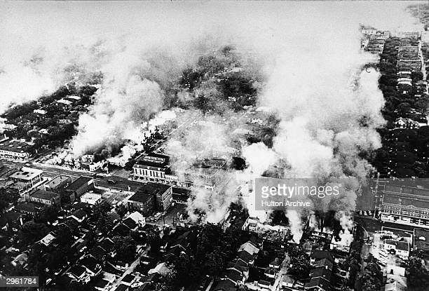 Aerial view of widespread fires started during the riots in Detroit Michigan July 1967